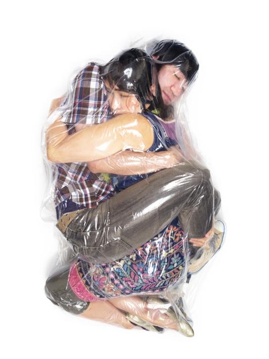 haruhiko-kawaguchi-vacuum-seals-couples-in-plastic-bags-for-art-body-image-1424826530